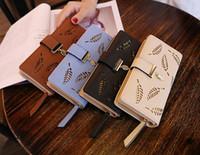 ingrosso cavità portafogli nuovi donne-2018 New fashion wallet Pacchetto carte con fibbia Foglie decorazione cava Portafoglio donna a portafoglio lungo tratto