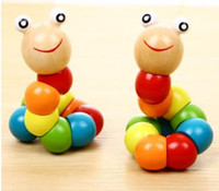 Hot sale 3 selling, changing, twisting, Rainbow people, baby building blocks, puzzle toys, early taught wooden caterpillars.