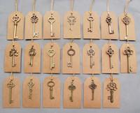 ingrosso vendita di chiavi di scheletro-etichetta kraft Misto 100 pezzi Bronzo antico Vintage 100 pezzi Kraft Tag Scheletro di chiavi di nozze Charm vecchio Fahshion in vendita