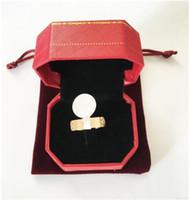 anillo de acoplamiento al por mayor-Anillos de amor de titanio de acero inoxidable para mujeres, hombres y mujeres Parejas de circonio cúbico Anillos de boda Logo Bague Femme 5mm con paquete