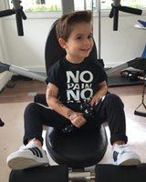 Wholesale cool baby clothes suits for sale - Group buy Fashion Boy s Suit Toddler Kids T shirt Baby Outfits Black Hot Boy Clothes No Pain No Gain Letters Printed Top XO Pants Cool Child Sets