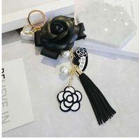 ingrosso catena chiave in pelle nera-Portachiavi famoso marchio Portachiavi fiore fiore camelia nera bianco portachiavi fiore moda donne llaveros flore borsa charms