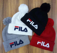 Wholesale TOP quality Unisex Beanies men autumn winter casual brand FILA knitted Hat letter embroidery ladies pom pom gorros women caps Guitar Strap