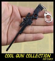 siyah oyuncak tabanca toptan satış-Siyah Gun Serisi Tüfek Sniping Gun Mini Modeli Anahtarlık Koleksiyonu K2 Saldırı Tüfeği AWP Sniper Oyuncak Tabanca Takı Metal Anaht ...