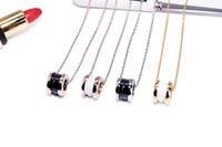 14k weißgoldketten großhandel-Schwarze und weiße Keramik Halskette 18K Rose Gold Anhänger Kette Knochen Titan Stahl Feder Anhänger Halskette