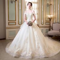 marfim casamento designer vestidos venda por atacado-Novo designer princesa árabe igreja vestido de baile vestidos de casamento plus size fora do ombro champanhe ouro frisado lace corset marfim vestidos de noiva