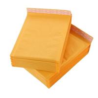 papel kraft gratis al por mayor-110 * 130mm Kraft Papel Burbuja Sobres Bolsas Burbuja de correo Bolsa de correo Remolques de Envío Acolchado Envoltura de Suministros de Negocios envío gratis