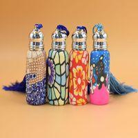 óleos essenciais de garrafas de argila venda por atacado-10ml de vidro rolo de perfume na garrafa com bola de vidro garrafa de óleo essencial de rolo de argila do polímero muitos padrões