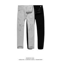 super gerippte jeans großhandel-New Black Ripped Jeans Männer Mit Löchern Super Skinny Berühmte Designer Marke Slim Fit Zerstört Torn Jean Hosen Für Männer