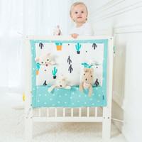 pañal de cuna al por mayor-Nuevo diseño Muselina Cama de árbol Colgante Bolsa de almacenamiento Cuna Cama de bebé Marca Cuna de algodón para bebés 50 * 60 cm Bolsillo de pañales de juguete para cuna Juego de cama