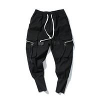 calças pretas longas venda por atacado-Calças Harem Loose Mens Hip Hop Calças Compridas Jeans KANYE WEST Streetwear Moda Jeans Elástico Na Cintura Preto Jeans High Street