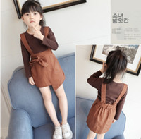 Wholesale Child Round Skirt - 2018 New children outfits spring girls round collar long sleeve T-shirt+Bows belt double pocket Irregular suspender skirts 2pcs sets R2110
