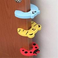 Wholesale child safety door holder online - 10pcs set Baby Safety Locks Cartoon Animal Jammers Stopper Children Guards Door Holder Kids Finger Protector