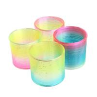 juguete circulo arcoiris al por mayor-niños Magic Plastic Slinky Rainbow Spring Colorido Nuevos Niños Funny Classic Toy Color al azar Rainbow Circle Coil Elastic ring.