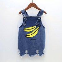 детские коляски оптовых-Baby Girls джинсовая юбка банан мультфильм принт брекеты юбка джинсовая юбка лето с подтяжкой длиной до колен 3-7 т