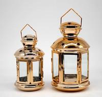 vintage kerzenständer großhandel-Hängende Laterne Kerzenhalter hohlen Halter Teelicht Kerzenhalter Vintage goldene marokkanische Kerze Laternen Home Hochzeit Dekoration