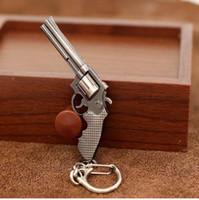 пистолетный пистолет оптовых-Мода миниатюрный револьвер пистолет оружие мода модель брелок брелок брелки новый мини-пистолет брелок для мужчин ювелирные изделия сюрприз подарок