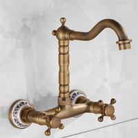 Wholesale antique brass bathroom faucet - Rotatable Minimalism Water Tap Brass Mounted Kitchen Bathroom Sink Faucet Dual Antique Entry Into The Wall Stopcock Home Decor yj jj
