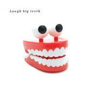 amigos de escritorio al por mayor-Los divertidos dientes grandes en la cadena El escritorio Los dientes grandes creativos Mecanismo Juguetes de descompresión Enviar amigos Regalos de cumpleaños para niños