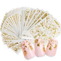 nail designs 3d blumen großhandel-20 Blatt Gold 3d Nail art Aufkleber Hohl Decals Mixed Designs Klebstoff Blume Nagelspitzen Dekorationen Salon Zubehör