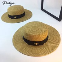 sombrero de paja de oro de las señoras al por mayor-Primavera y verano nuevo retro dorado trenzado cabeza plana sombrero de paja dama amplia aleros protector solar sombrero de verano gorra S18101708