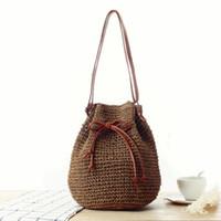 Wholesale pump weaves - The new pumping shoulder woven bag ethnic style fashion grass bag leisure beach bag buckle handbags
