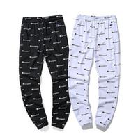 pantalones jogger coreano al por mayor-Otoño Nueva Moda Coreana Hombres Pantalones de Chándal Pantalones de Harén Sueltos Pantalones Cordón Negro Blanco Joggers