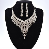 Wholesale wedding diamond earings - Simple New Wedding Jewelry Water Drop Crystal Collarbone Chain Necklace Set Bridal Jewelry Pearls Luxury Bracelets Necklace & Earings LD016