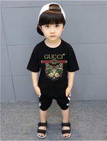 kinder t-shirts großhandel-2018 neue Marke Designer Marke 2-9 Jahre alt Baby Jungen Mädchen T-Shirts 2018 Sommer Shirt Tops Baumwolle Kinder Tees Kinder Kleidung 2 Farben