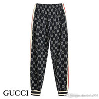 beyzbol ceketleri spor giyim toptan satış-2019 Gucci yeni moda erkek spor takım elbise beyzbol ceket erkekler ve kadınlar çift spor fermuar pantolon takım bayanlar lüks spor pantolon S-2XL