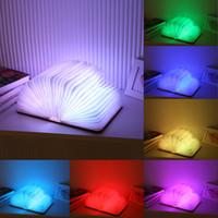 holzlampen großhandel-Freies Verschiffen 7 bunte hölzerne Drehenbücher Nachtlicht USB wieder aufladbare LED faltende Lampen-Buch-kreative Art- und Weisegeschenk-Tischlampe