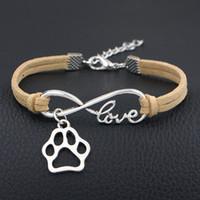 mode chien coréen achat en gros de-La mode Infinity Love Dog Griffe Paw Rope bracelet tissé à la main 12 Couleur argent bracelets de velours coréen femmes Fashion Wrap Beige Bijoux en cuir