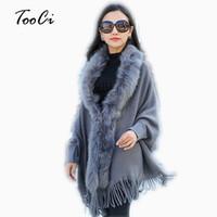 poncho de capa beige al por mayor-Moda nuevo otoño e invierno de las mujeres cuello de piel sintética cabo chal Cardigan mujeres borla de punto cardigan suéter poncho D1892001