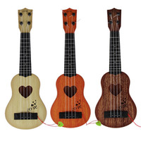 Wholesale string guitars for sale - Mini Strings Guitar Children Toy Gift Ukulele Early Musical Education Toys Multi Color yf C R