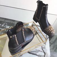 botas de borla de metal venda por atacado-Botas de tornozelo mulher nova Designer de moda mulheres de Couro Preto Com Spikes Toe High Top Red Bottom Botas de metal rebites Martin botas US5-9