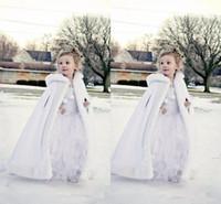 fuchsia bolero jacken großhandel-2019 New Günstige Hooded Flowers Mädchen Cape Nach Maß Für Hochzeit Mäntel Weihnachten Weiß Elfenbein Kunstpelz Winter Hochzeit Jacke Wraps Lange