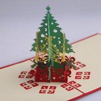 cartes de noël faites à la main achat en gros de-Cartes de voeux de Noël 3d fait main pop up cartes de vœux 3D carte de papeterie cadeau de Noël à la main rétro percé poster cartes-cadeaux GGA1182