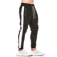 штаны для мужчин оптовых-2018 новые мужские спортивные брюки весна осень свободного покроя брюки мужчины тонкий Fit брюки мужской эластичные боковые полосы мужская мода брюки
