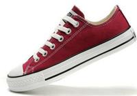 calçado de lona superior venda por atacado-Sapatos de lona das mulheres baixos top série Mens clássico Lace up amante sapatas de lona calçados unisex Sapatilhas sapato business casual shoes