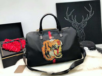 Wholesale pink tiger cartoon resale online - Pink sugao designer duffle bag Embroidered tiger travel tote purses and handbags shoulder crossbody luxury travel organizer famous brand