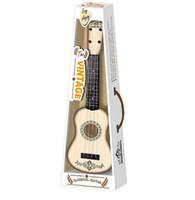 guitarras de juguete al por mayor-NFSTRIKE Tipo de guitarra para niños Ukulele 4 cuerdas Aprendizaje de los instrumentos musicales educativos tempranos Juguetes para niños - Grano de madera blanca