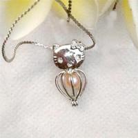 perlas de gato gatito al por mayor-Accesorios colgantes de la jaula del gatito del gato, puede abrir y sostener la jaula del medallón del grano de la gema de la perla, encantos accesorios de la joyería de la manera de DIY P19
