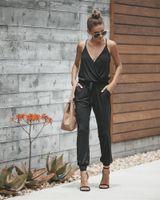 mono negro delgado al por mayor-2018 Summer Woman Jumpsuit Sexy con cuello en V Strips Black Slim Fenale Monos Pantalones largos sueltos Casual Fashion Lace Up Slim Jumpsuit