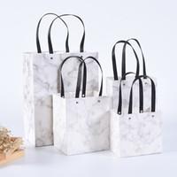 quality white paper 도매-10 PC / lot 화이트 골 판지 유니버설 휴대용 종이 가방 사용자 지정 마블 종이 가방 고품질 평방 선물 가방