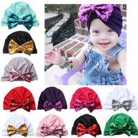 ingrosso i cappelli infantili fanno-30pcs Natale Neonate Paillettes arco annodato Caps copricapo Infant Toddler Bambini Boemia cappelli bambini Accessori per capelli