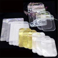 sacos plásticos auto-selados venda por atacado-Zip Lock Plástico Transparente + ouro Prata Não-tecido Auto Seal Zipper Pacote de Embalagem de Varejo Saco Poly Opp sacos de Embalagem Para telefone case usb cabo carregador