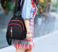 Wholesale Cloth Soft Book - Female bag. Backpack. Little knapsack. Casual fashion woman bags. Nylon cloth. Shell bag. Book bag. Handbag. Backpack Style. Small.