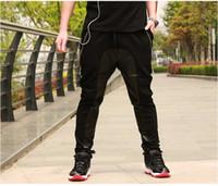 ingrosso pantaloni corti degli uomini-Pantaloni in pelle con cavallo basso in pelle da uomo Pantaloni sportivi in jogging pantaloni Hip Hop in pelle Harem Baggy Pyrex