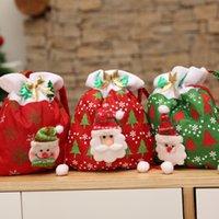 geschenk taschen band großhandel-New Weihnachtsgeschenktasche Weihnachtsmann Schneemann nettes Muster mit einem Band setzte Geschenk Süßigkeiten feiern