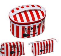 sacs coréens du sud achat en gros de-La version sud-coréenne de la nouvelle mode compacte 100 tambour grande capacité voyage sac cosmétique rayure sac à main étanche sac à cosmétiques